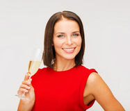 Woman in red dress with a glass of champagne Royalty Free Stock Photography