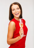Woman in red dress with a glass of champagne Stock Photography