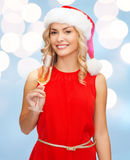 Woman in red dress with a glass of champagne Stock Photos