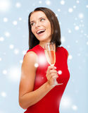 Woman in red dress with a glass of champagne Royalty Free Stock Photos