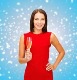 Woman in red dress with a glass of champagne Stock Image
