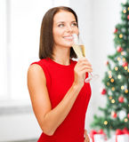 Woman in red dress with a glass of champagne Royalty Free Stock Images