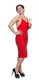 Woman in red dress with glass, white background. Royalty Free Stock Image