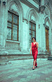 Woman in red dress gothic home in front Stock Photos