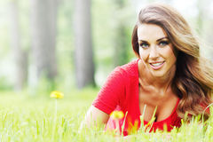 Woman in red dress on grass Stock Image