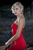 Woman in red dress with gun Royalty Free Stock Photography