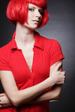 Woman with red dress and hair. Young beautiful woman with red dress and hair Royalty Free Stock Image