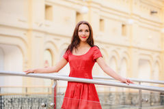 Woman in red dress about handrail Stock Photography