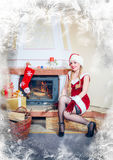 Woman in a red dress and hat of Santa Stock Photography