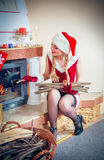 Woman in a red dress and hat of Santa Stock Images
