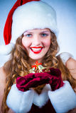 Woman in a red dress and hat of Santa with a christmas Royalty Free Stock Photography