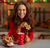 Woman in red dress having snack in christmas decorat Royalty Free Stock Photos