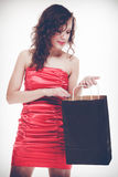 Woman in red dress hold shopping bag Royalty Free Stock Image