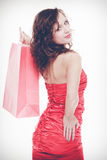 Woman in red dress hold shopping bag Stock Photos