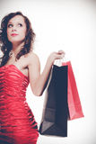Woman in red dress hold shopping bag Stock Images