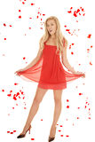 Woman red dress hold skirt rose petals. Royalty Free Stock Photo