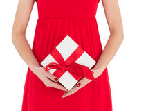 Woman in red dress holding gift Stock Photos