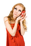 Woman in red dress holding gift-box Royalty Free Stock Photos