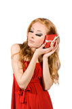 Woman in red dress holding gift-box Stock Images