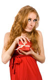 Woman in red dress holding gift-box Royalty Free Stock Image