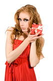 Woman in red dress holding gift-box Stock Photos