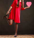 Woman in red dress holding heart box. Stock Photos