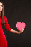 Woman in red dress holding heart box. Royalty Free Stock Photography