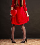 Woman in red dress holding heart box. Royalty Free Stock Photo