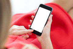 Woman in red dress holding a phone with  screen Stock Images