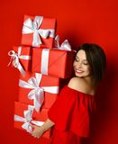 Blithesome birthday girl in dress posing with presents. royalty free stock photography
