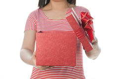 Woman in red dress  Holding red gift on isolate on white background Royalty Free Stock Photography