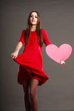 Woman in red dress holds heart sign Royalty Free Stock Photography