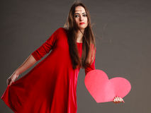 Woman in red dress holds heart sign Stock Photos