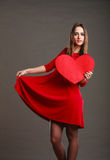 Woman in red dress holds heart sign Royalty Free Stock Photo