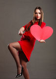 Woman in red dress holds heart sign Stock Image