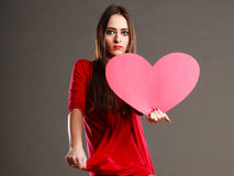 Woman in red dress holds heart sign Stock Photography