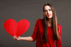 Woman in red dress holds heart sign Royalty Free Stock Photos