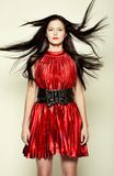 Woman in red dress with long dark hair Stock Images