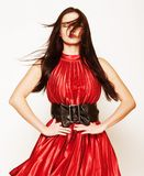 Woman in red dress with long dark hair Royalty Free Stock Photography