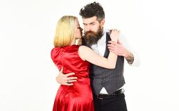 Woman in red dress and man in vest. Bearded hipster and attractive lady dressed up for dancing contest. Couple in love. Woman in red dress and men in vest Stock Photo