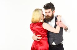 Woman in red dress and man in vest. Bearded hipster and attractive lady at dancing contest, copy space. Couple in love. Woman in red dress and men in vest Royalty Free Stock Images