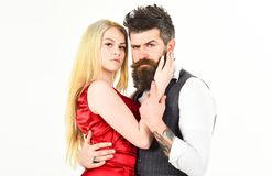 Woman in red dress and man in vest. Dancing couple concept. Bearded hipster and attractive lady dressed up for dancing. Woman in red dress and men in vest Stock Image