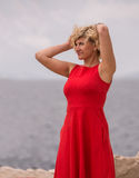 Woman in red dress near of the sea Stock Photo