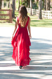 Woman in a red dress outside Stock Photos