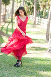 Woman in a red dress outside Royalty Free Stock Photography