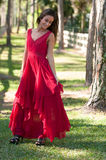 Woman in a red dress outside Royalty Free Stock Image