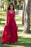 Woman in a red dress outside Royalty Free Stock Photos