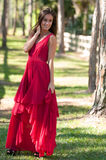 Woman in a red dress outside Royalty Free Stock Photo