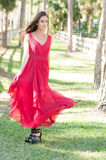 Woman in a red dress outside Stock Image