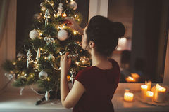 Woman in red dress over christmas tree background Stock Images